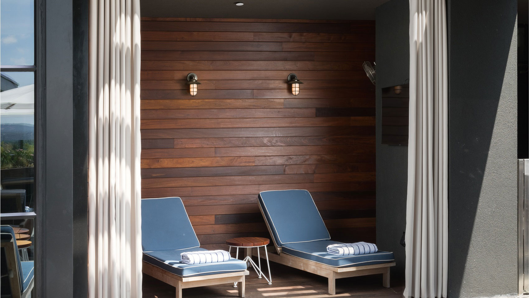 Hotel Van Zandt Austin Outdoor Pool lounge chairs in a cabana