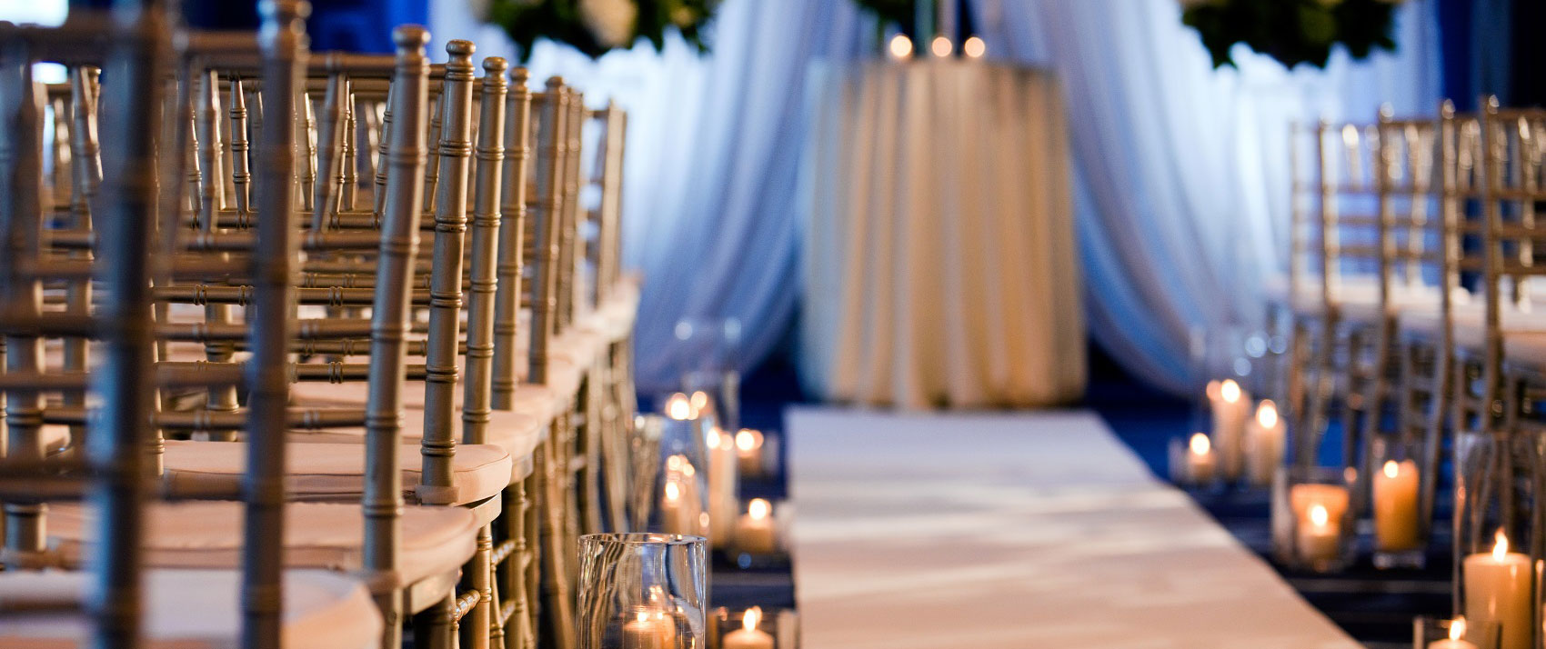wedding aisle with chairs and candles
